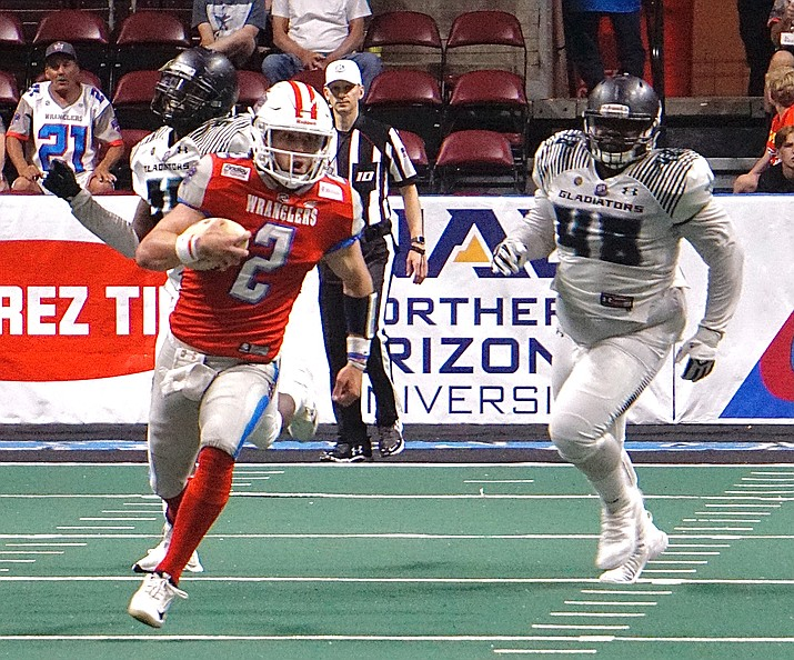 Northern Arizona Wranglers quarterback Caden Walters (2) runs the ball during an Indoor Football League game against the Duke City Gladiators on Saturday, June 12, 2021, at the Findlay Toyota Center in Prescott Valley. The Wranglers lost to the Gladiators 34-17. (Aaron Valdez/Courier)