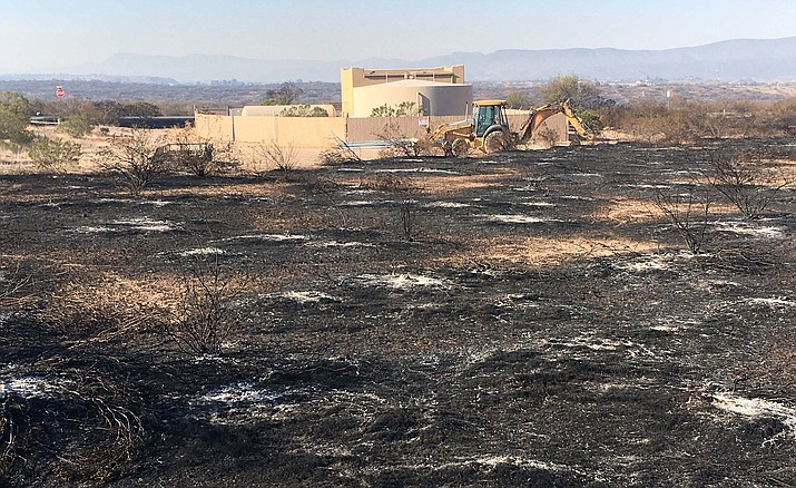 Monday, a backhoe was seen at this charred area northeast of Cornville. There was much less smoke visible at the 1200-acre fire Monday than there had been in the fire's initial stages Sunday. VVN/Vyto Starinskas