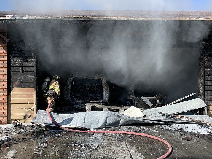 A firefighter works a garage fire that may have been started by an explosion Monday, June 14, 2021. (Prescott FD/Courtesy)