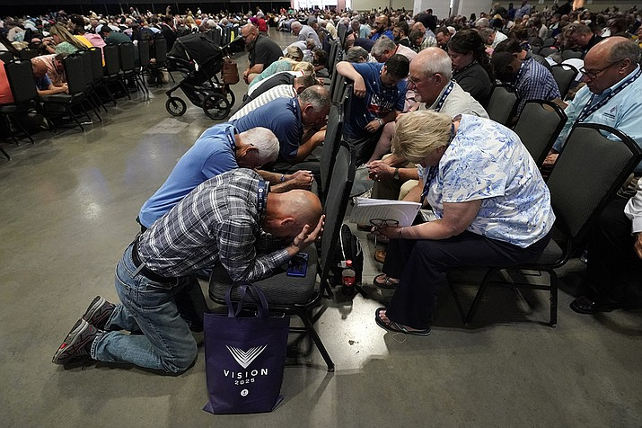 People pray during the annual Southern Baptist Convention meeting Tuesday, June 15, 2021, in Nashville, Tenn. (Mark Humphrey/AP)