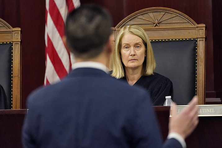 Attorney Andy Gaona presents oral arguments as Arizona Supreme Court Vice Chief Justice Ann A. Scott Timmer listens, April 20, 2021, in Phoenix. A trial judge has tossed out most of the remaining claims of foes seeking to void the voter-approved income tax surcharge to fund public education. But that doesn't mean the levy ultimately will be upheld, with one issue still set for trial. And the final word will be up to the Arizona Supreme Court. (Matt York/AP, file)