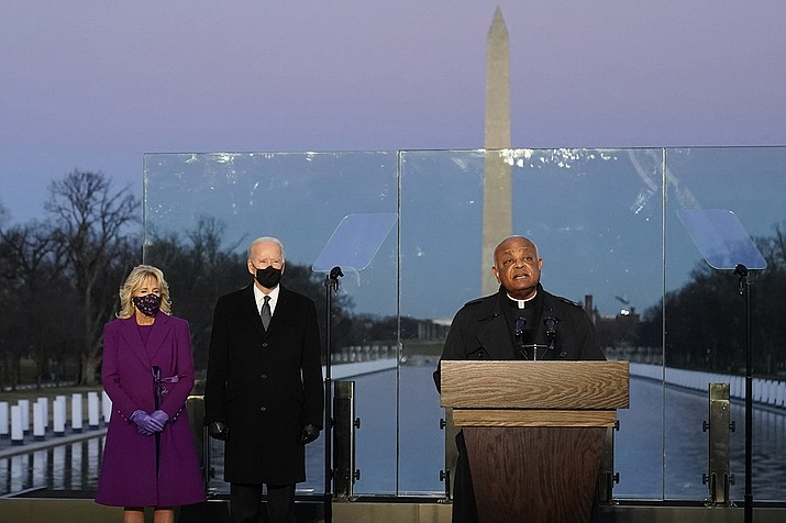 In this Tuesday, Jan. 19, 2021 file photo, President-elect Joe Biden and his wife, Jill, listen as Cardinal Wilton Gregory, Archbishop of Washington, delivers the invocation during a COVID-19 memorial at the Lincoln Memorial Reflecting Pool in Washington. Gregory has made clear that President Biden, who sometimes worships in Washington, is welcome to receive Communion at the archdiocese's churches. (AP Photo/Alex Brandon, AP File)