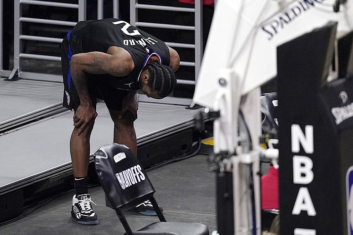Los Angeles Clippers forward Kawhi Leonard holds his knee after stepping awkwardly during the second half in Game 4 of a second-round NBA basketball playoff series against the Utah Jazz Monday, June 14, 2021, in Los Angeles. ( Mark J. Terrill/AP)