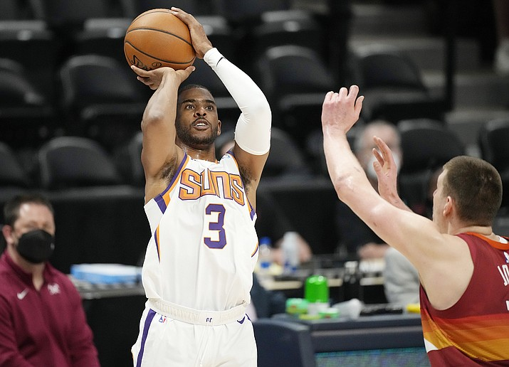 Phoenix Suns guard Chris Paul shoots for a basket as Denver Nuggets center Nikola Jokic defends in the first half of Game 4 of an NBA second-round playoff series Sunday, June 13, 2021, in Denver. (David Zalubowski/AP)