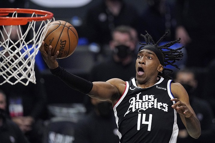 Los Angeles Clippers guard Terance Mann shoots during the second half in Game 6 of a second-round NBA basketball playoff series against the Utah Jazz Friday, June 18, 2021, in Los Angeles. (Mark J. Terrill/AP)