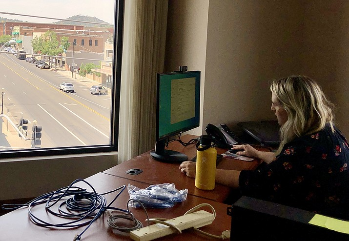 Sarah Ramm, IT specialist with the city, works on getting the technology installed in one of the offices at the National Bank building that will serve as space for the Human Resources Department. Prescott's move to the newly purchased building began Thursday, June 17, 2021. (Cindy Barks/Courier)