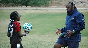 Happy Father's Day: Phil Reid forms special bond with 11-year-old daughter in soccer, life photo