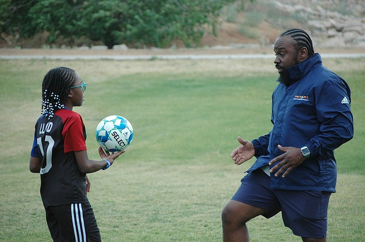 Former Prescott High boys soccer coach Phil Reid teaches his 11-year-old daughter, Khloe, the ins and outs of soccer as she grows into the game. On Wednesday afternoon, June 16, 2021, at Bob Edwards Park in Prescott Valley, Phil and Khloe spent time on drills. (Doug Cook/Courier)