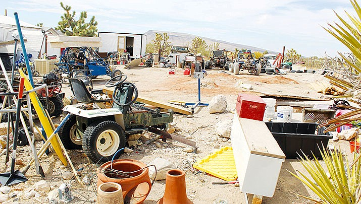"""A search warrant was served at this residence in Dolan Springs, part of a week-long operation that resulted in law enforcement discovering two """"chop shops"""" used for dismantling stolen cars. (MCSO photo)"""