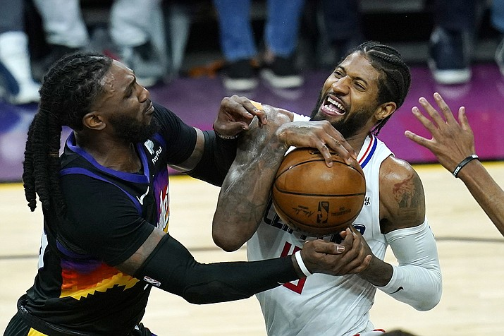 Los Angeles Clippers guard Paul George, right, reacts as he is stopped in the lane by Phoenix Suns forward Jae Crowder, left, during the second half of Game 1 of the NBA basketball Western Conference finals Sunday, June 20, 2021, in Phoenix. (Ross D. Franklin/AP)