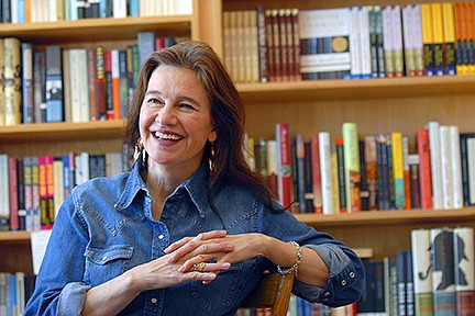 """Author Louise Erdrich reflects on growing up in North Dakota and her new book """"The Plague of Doves"""" at her store BirchBark Books in Minneapolis. (AP Photo/Dawn Villella, File)"""