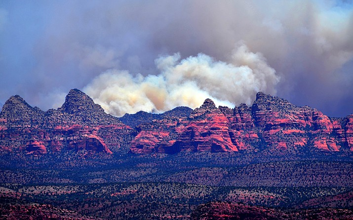 The Rafael Fire continued to spread on Monday and can be seen in these photos from Perkinsville Road. It is centered about four miles east of Perkinsville and has grown to 20,000 acres. The fire can be seen from Cottonwood, Sedona and Jerome. VVN/Vyto Starinskas