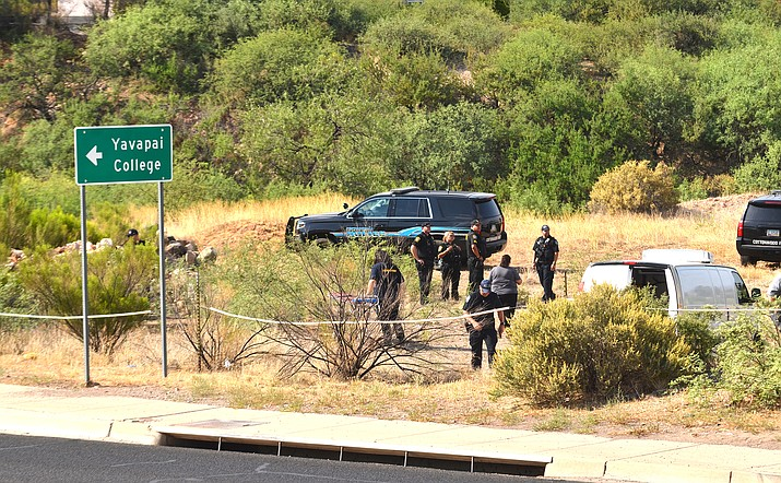 Cottonwood Police Saturday afternoon investigate the scene where a body was discovered in a ravine along State Route 89A. VVN/Vyto Starinskas