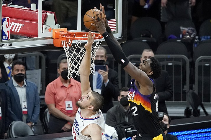 Phoenix Suns center Deandre Ayton, right, scores over Los Angeles Clippers center Ivica Zubac during the second half of Game 2 of the NBA basketball Western Conference Finals, Tuesday, June 22, 2021, in Phoenix. (Matt York/AP)