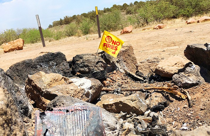 """""""No fires"""" flags marked the closure of the Coconino National Forest that began Wednesday. The Prescott National Forest is imposing the same restriction, effective 8 a.m. Friday, June 25. VVN/Vyto Starinskas"""