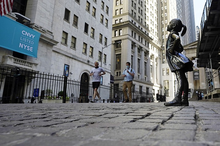 """The """"Fearless Girl"""" statue faces the New York Stock Exchange, Wednesday, June 16, 2021.  Stocks are opening broadly higher on Wall Street Friday, June 25 keeping the S&P 500 on track for its biggest weekly gain since April. (Richard Drew/AP)"""