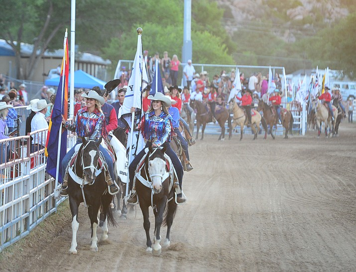 """This 2019 file photo shows the grand entry beginning the """"World's Oldest Rodeo"""" at Prescott Frontier Days. In 2020, COVID-19 forced Prescott Frontier Days to allow only 25% capacity, but with nearly half the population in Arizona and across the U.S. vaccinated, this summer's rodeo is returning to Prescott in full force. """"We're seeing it around the country. People are ready to get out and get stuff going, get out and do something and there's going to be some great rodeo action for them which they can watch,"""" new General Manager Jim Dewey Brown said about the """"World's Oldest Rodeo,"""" which begins Monday, June 28, 2021, and runs through Sunday, July 4. (Courier file photo)"""
