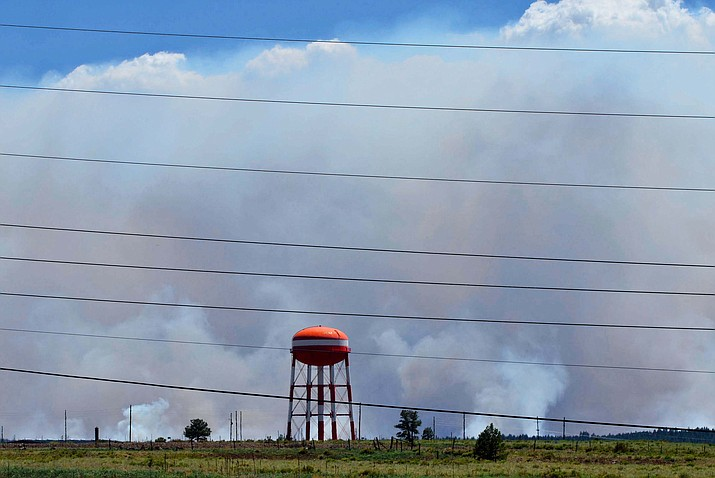 As seen from I-40 on Sunday, the Rafael Fire was still producing a great deal of smoke. However, both the Rafael and Backbone fires were past 40% Monday in containment. VVN/Vyto Starinskas