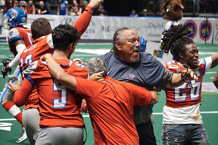 Northern Arizona Wranglers head coach Dominic Bramante, second from right, celebrates with players and coaching staff after the team defeated the Tucson Sugar Skulls for their first win in franchise history on Saturday, June 26, 2021, at the Findlay Toyota Center in Prescott Valley. (Aaron Valdez/Courier)