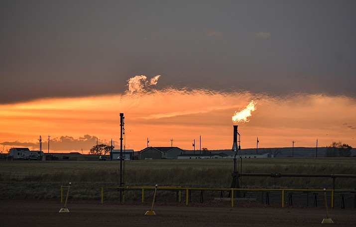 Flares burn natural gas from oil production in the Fort Berthold Indian Reservation east of New Town, North Dakota. (AP Photo/Matthew Brown)