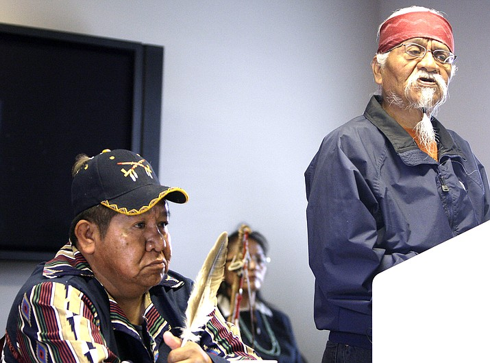 Arizona Havasupai Indian tribe member, elder, and spiritual leader, Rex Tilousi, right, speaks during a news conference in Phoenix, as tribe member Dennie Wescogame listens. Tilousi, 73, died last week of natural causes with his family by his side. Services for Tilousi began June 25 with a traditional wake at the family's home in the village of Supai. (AP Photo/Ross D. Franklin, File)