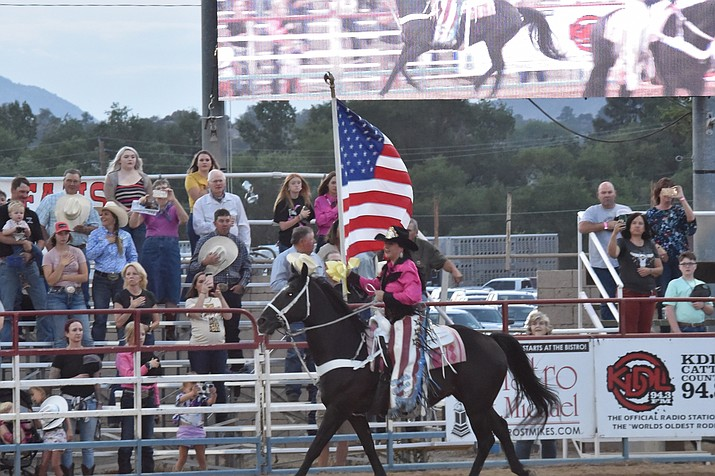 A salute to the flag on the second performance of the Prescott Frontier Days Rodeo Tuesday, June 29, 2021. (Jesse Bertel/Courier)