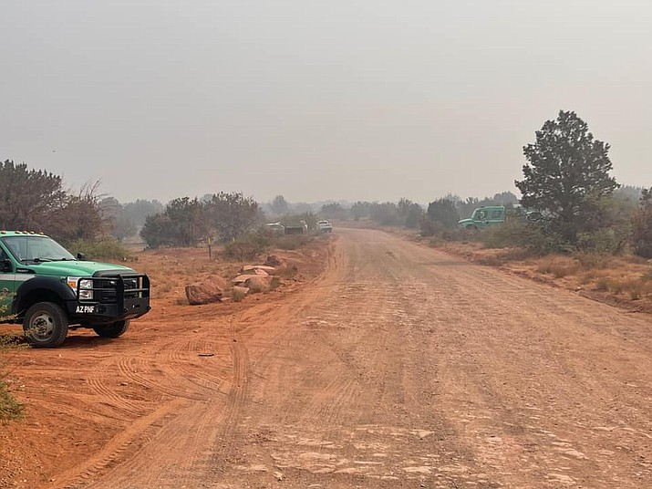 Firefighter vehicles line a forest road in Coconino County on June 26, 2021. Fire officials say that the Rafael Fire is 59% contained and has burned 78,708 acres as of Tuesday, June 29, 2021. (YCSO/Courtesy)