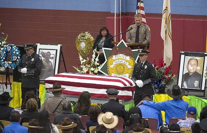 In this March 16, 2017 file photo Chaplain Mark Morris speaks during a memorial service for fallen Officer Houston Largo at Rehoboth Christian School in Gallup, N.M. The man who gunned down a tribal police officer in a remote corner of the nation's largest American Indian reservation has been sentenced to 30 years in federal prison.(Cayla Nimmo/Gallup Independent via AP,File)