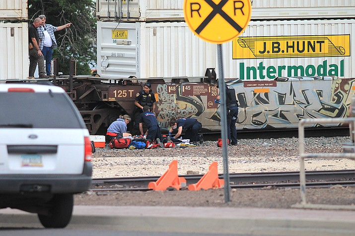First responders tend to a woman struck by a train in Williams June 30. (Photo/WGCN)
