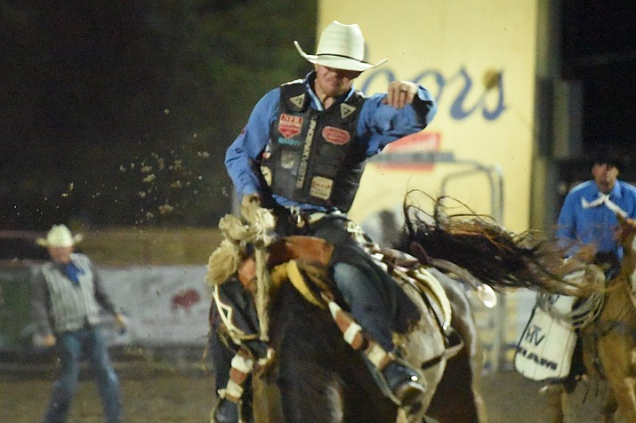 Jacobs Crawley rides in the saddle bronc competition at the third performance of the Prescott Frontier Days Rodeo Wednesday, June 30, 2021. (Jesse Bertel/Courier)