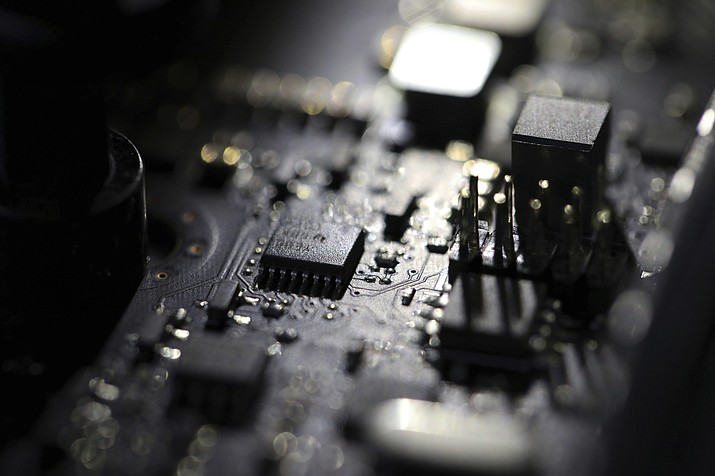 This Feb 23, 2019 photo shows the inside of a computer in Jersey City, N.J. A ransomware attack paralyzed the networks of at least 200 U.S. companies on Friday, July 2, 2021, according to a cybersecurity researcher whose company was responding to the incident. (Jenny Kane/AP, File)