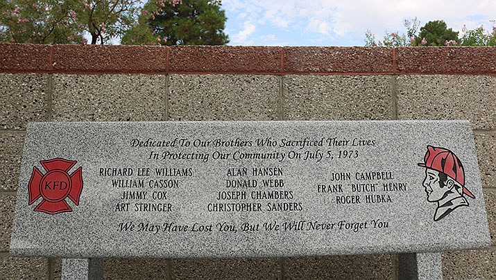This tribute at Firefighters Memorial Park is just one of the memorials to the 11 volunteer firefighters who died in a propane explosion in Kingman on July 5, 1973. (Photo by Travis Rains/Kingman Miner)