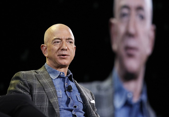 In this June 6, 2019, file photo Amazon CEO Jeff Bezos speaks at the the Amazon re:MARS convention in Las Vegas.  The Amazon founder officially stepped down as CEO on Monday, July 5, 2021, handing over the reins as the company navigates the challenges of a world fighting to emerge from the coronavirus pandemic. Andy Jassy, the head of Amazon's cloud-computing business, replaced Bezos, a change the company had announced in February.  (John Locher/AP, file)
