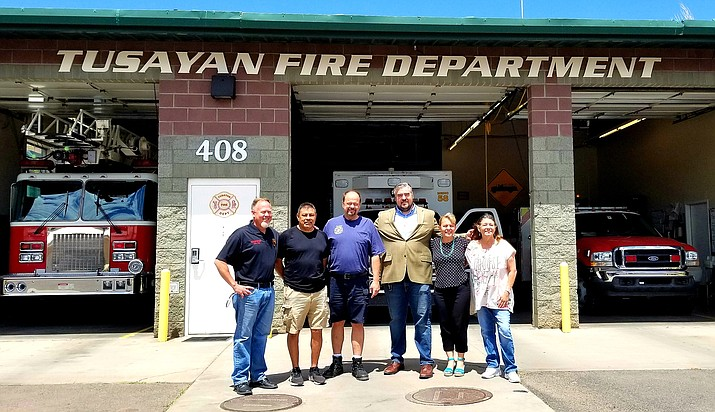 Tusayan Fire District and Tusayan Town Council delegates celebrate the signing of a new Inter-governmental Agreement June 29. From left: TFD Board President John Vail, TFD Board Clerk Andrew Aldaz, Fire Chief Greg Brush, Tusayan Vice Mayor Brady Harris, Mayor Clarinda Vail and TFD board member Becky Shearer. (Lo Frisby/WGCN)