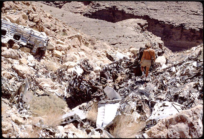 Above: A man walks through the debris at the crash site in Grand Canyon National Park. (Photo/NPS)