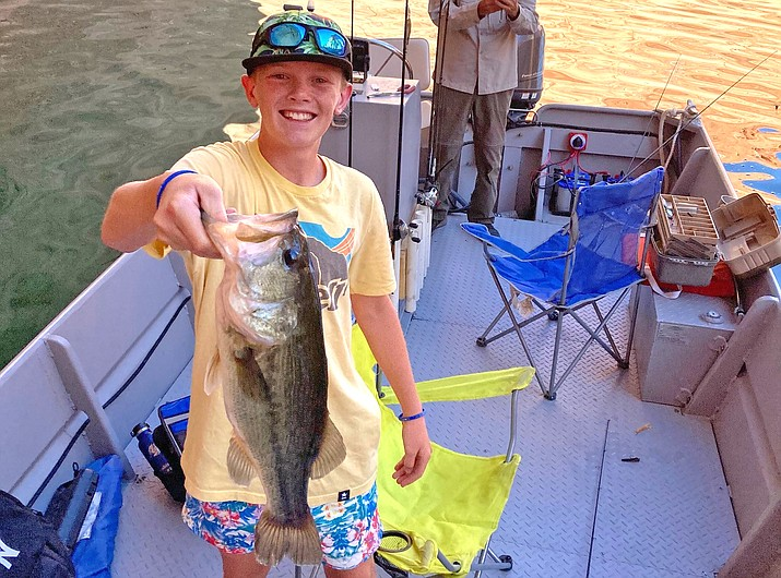 A fisherman shows off his catch at Lake Powell. (Submitted photo)