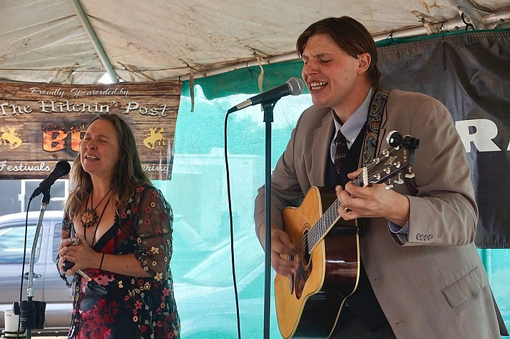 """Richard Strock, right, and Dani Fury team up to make the Peaceful Outlaws, a Chino Valley music duo. The band played at the """"World's Oldest Rodeo"""" in Prescott on Friday, July 2, 2021. (Aaron Valdez/Review)"""