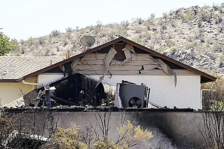 This photo shows the remains of a damaged home from the Spur Fire Friday, May 28, 2021. The fire burned dozens of acres and destroyed several homes and other structures in Bagdad, Arizona. (Rob Schumacher/The Arizona Republic via AP, Pool)