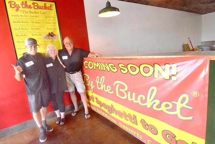 Bret daCosta, left, Linda Kaplan and Tom Barry pose at the By the Bucket store opening soon in the Fry's Shopping Center in Cottonwood. VVN/Vyto Starinskas