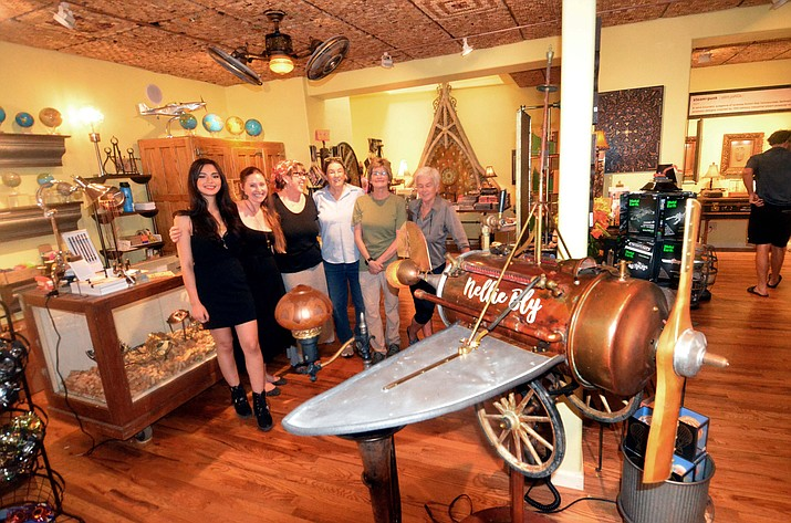 Mary Wills and Sally Dryer, on the right, are the owners of Nellie Bly Kaleidoscopes and Art Glass. They have opened an adjacent store called Round the World with Nellie Bly. They are pictured here with their staff. VVN/Vyto Starinskas