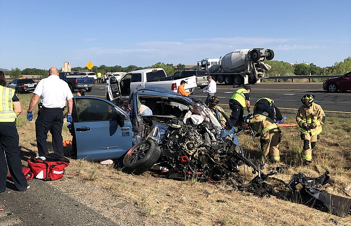 Firefighters and rescue personnel work the scene of a two-vehicle crash Friday morning, July 9, 2021, on Highway 89A. The crash resulted in two people - the drivers - deceased at the scene. (PPD/Courtesy)