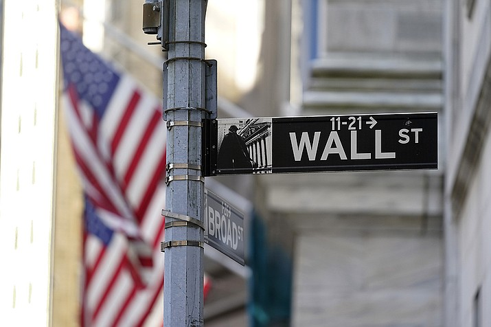 Flags adorn the facade of the New York Stock Exchange, Wednesday, June 16, 2021. Stocks are opening higher on Wall Street Friday, July 9, but the market is still on track to end this holiday-shortened week lower following two weeks of gains. (Richard Drew/AP)