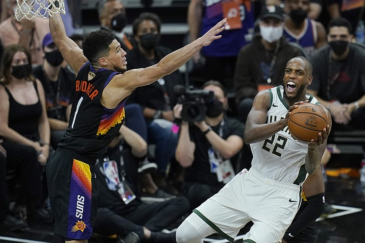 ABOVE: Milwaukee Bucks forward Khris Middleton (22) is defended by Phoenix Suns guard Devin Booker during the second half of Game 2 of the NBA Finals, Thursday, July 8, 2021, in Phoenix. (Ross D. Franklin/AP)