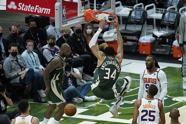 Milwaukee Bucks' Giannis Antetokounmpo (34) dunks during the first half of Game 3 of basketball's NBA Finals against the Phoenix Suns in Milwaukee, Sunday, July 11, 2021. (Paul Sancya/AP)