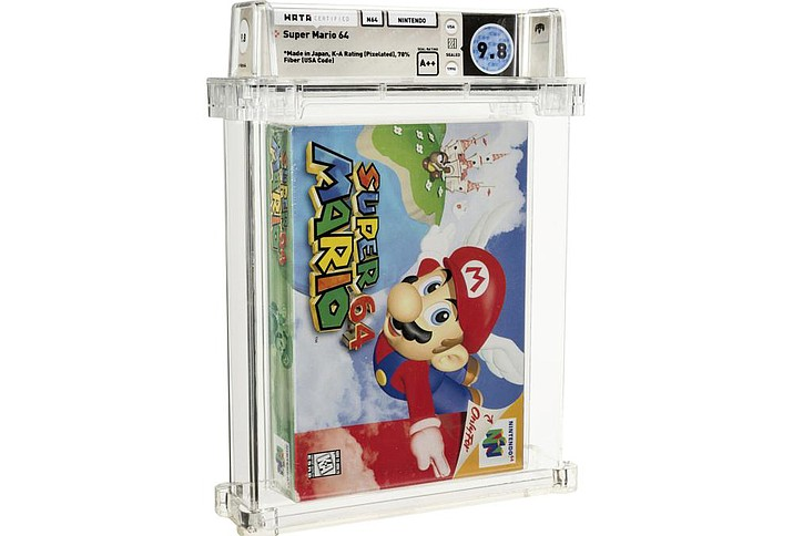 This photo shows an unopened copy of Nintendo's Super Mario 64 that has sold at auction for $1.56 million. Heritage Auctions in Dallas said that the 1996 video game sold Sunday, July 11, 2021, breaking its previous record price for the sale of a single video game. (Courtesy of Heritage Auctions via AP)