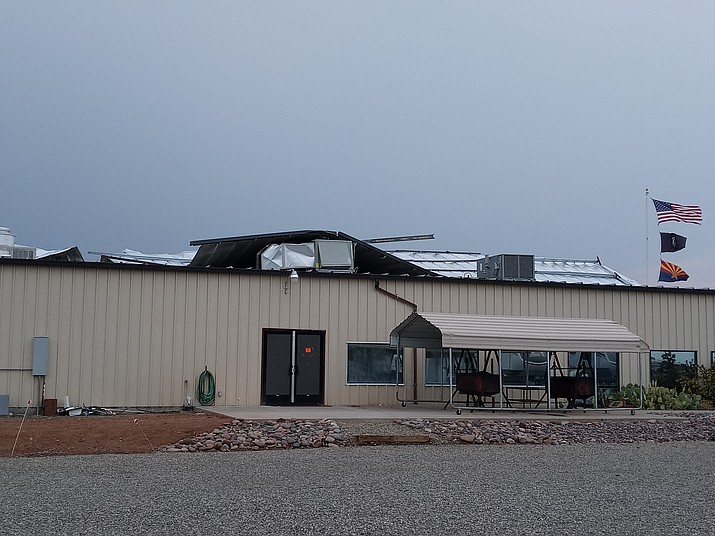 During a severe monsoon storm early Sunday night, July 11, 2021, high winds bent and tore half of the metal roof at the Prescott Elks Lodge, 6240 E. Second St., in Prescott Valley. The bent half of the roof landed on the other half of the roof that had not been dislodged, damaging several air conditioning units in the process. (Joe Hofmeister/Courtesy)