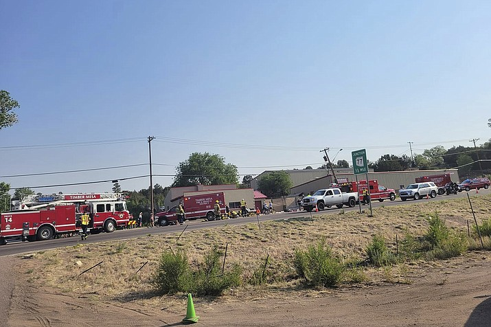 In this June 19, 2021, photo, released by the Timber Mesa Fire and Medical District, emergency personnel gather at the scene of a mass casualty incident near Downtown 9 in Show Low, Ariz. A cyclist has died after he was struck by an Arizona driver who plowed his pickup truck into a group of people participating in a bike race, authorities said. A 58-year-old man died of his injuries Saturday, July 10 Arizona Department of Public Safety spokesman Bart Graves said Monday, July 12. No other information about the victim was immediately released. The accused driver, Shawn Michael Chock, was indicted last week on aggravated assault with a deadly weapon and other charges. (Timber Mesa Fire and Medical District via AP, File)