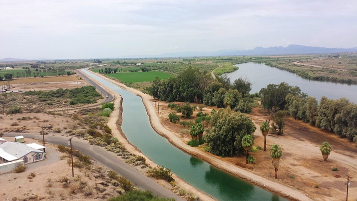 A canal system on the Colorado River Indian Tribes reservation is seen near Parker, Arizona. The tribe has played an outsized role in Arizona to help keep Lake Mead from falling to drastically low levels. Still, Arizona is expected to face the first-ever mandatory cuts to its Colorado River water supply in 2022. (Angie Ingram/CRIT Water Resources via AP)