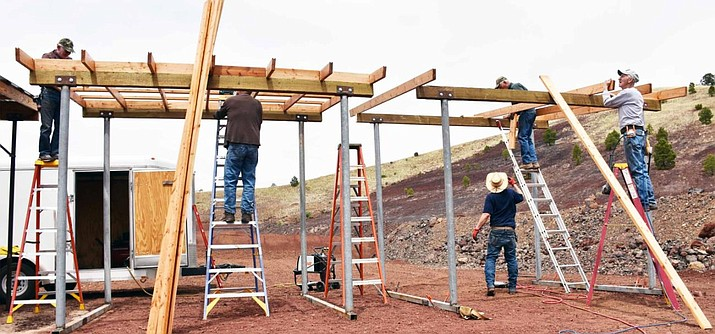 Williams Sportsmans Club members Warren Weir, Jack Douglas, Dale Vicari, Keith Heimes and Chuck Corcoran frame the roof on a new pistol shooting facility at the Williams Shooting Range.