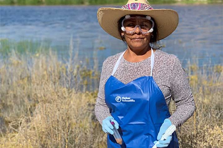 Diné College's School of S.T.E.M. student Tina Du Puy collects soil samples in 2019. (Photo courtesy Diné College)